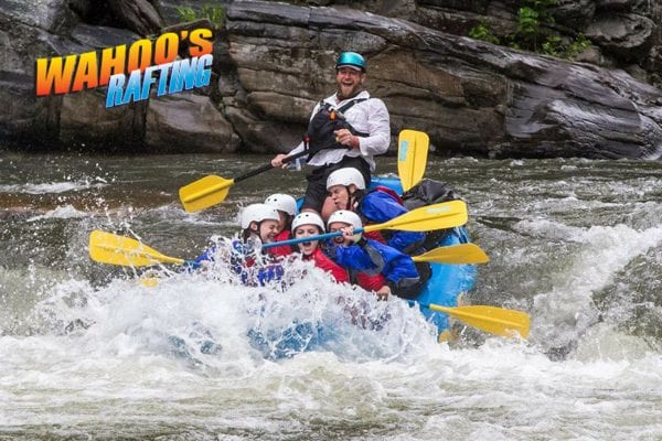 Wahoo Rafting logo on top right with rafting group